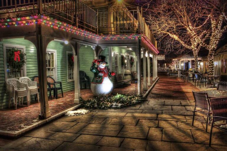 Picture of aHoliday scene with a snowman on a front porch